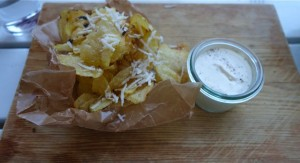 Chips with parmesan and a horseradish dip.